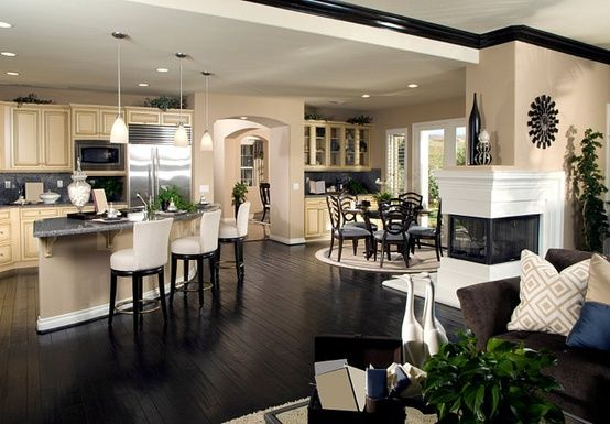 Love the color scheme and kitchen/dining room layout with that fireplace on the wall – LOVE the dark floors. @ Pin For Your Home