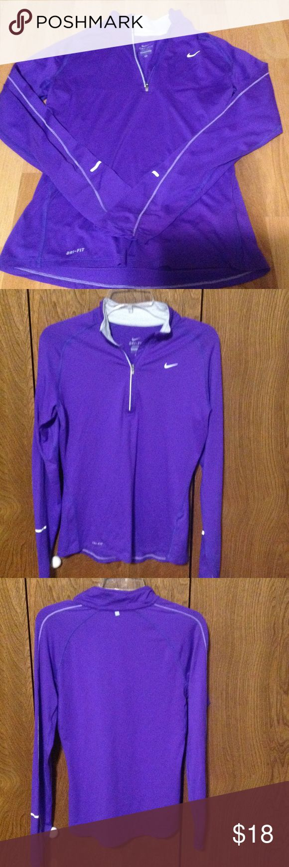 Nike Dri Fit Pullover jacket Nike Dri fit Pullover jacket . 1/4 Zip Up with reflective strips. In good condition. No holes, tears or stains. Nike Tops
