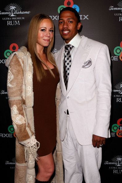 """Mariah Carey Photos - Actors/singers Mariah Carey and Nick Cannon attend the """"AXE Fix Club"""" held during the 2009 Sundance Film Festival and celebrating the new line of AXE body washes and sprays on January 17, 2009 in Park City, Utah.  (Photo by Michael Buckner/Getty Images for AXE) * Local Caption * Mariah Carey;Nick Cannon - 2009 Park City - AXE Fix Nightclub - Day 2"""