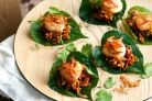 Create elegant Asian starters in minutes with these caramelised scallops on a bed of betel leaves.