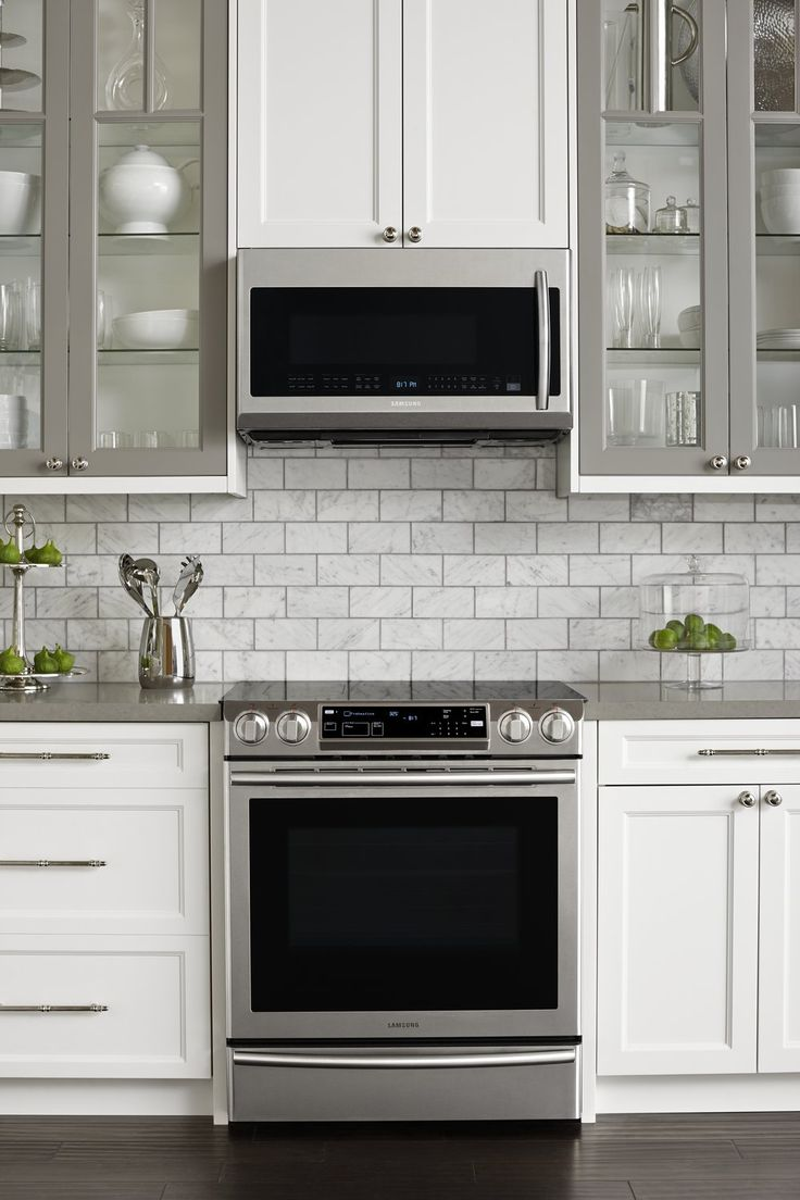 You can't see the entire kitchen here, but we like how well the stainless steel Samsung appliances go with the cabinets. The lime green accents add a nice pop of color.
