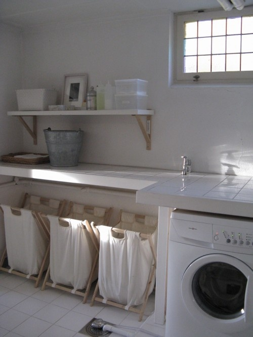 laundry with linen material baskets and open shelving. #laundry