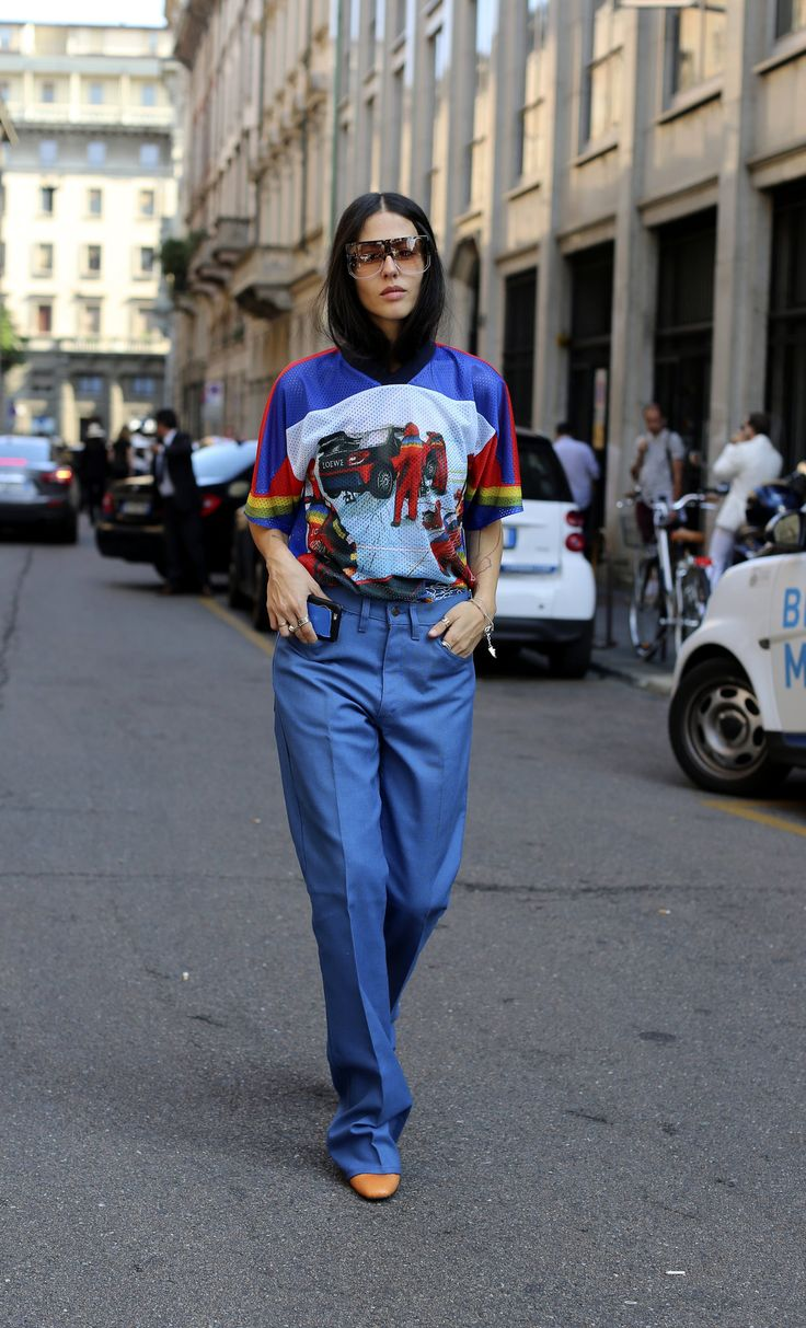 Graphic tee with extra-long trousers during Milan Fashion Week. (Photo: Lee Oliveira for The New York Times)