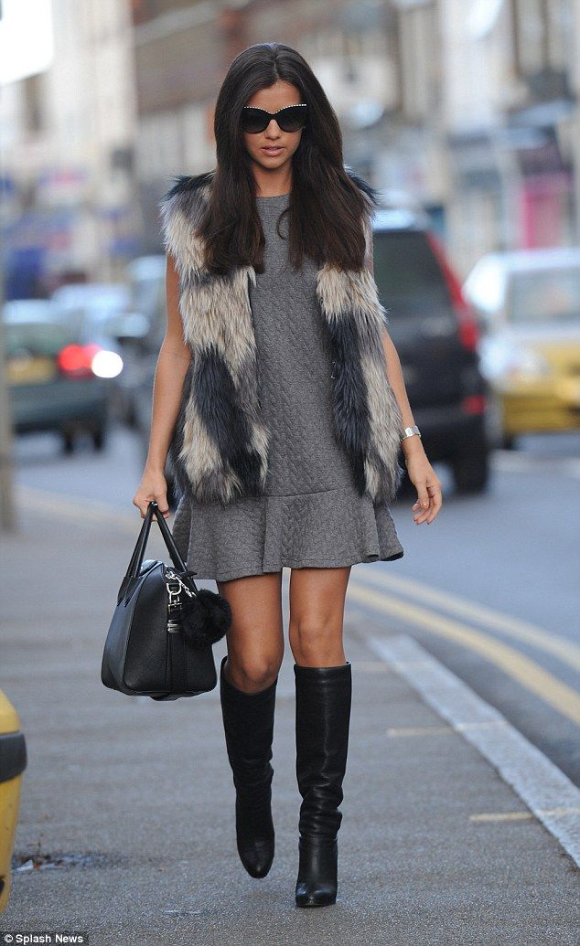 Wow thing: Lucy Mecklenburgh cut a glamorous figure as she made her way to her Essex boutique on Saturday in a furry gilet and knee high boots