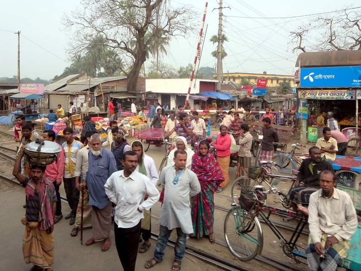 Local people waiting for the train to go by at a level crossing between Rajshahi and Khulna, Bangladesh.