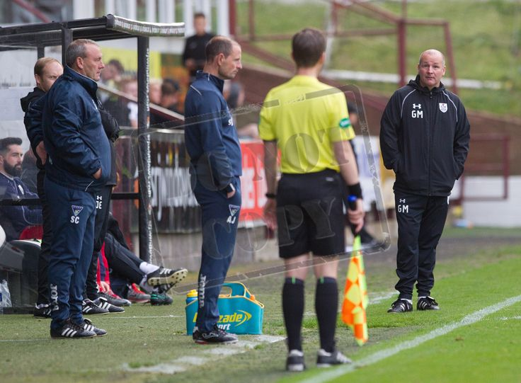 Queen's Park's Gus MacPherson questions the assistant referee during the IRN-BRU Cup game between Dunfermline Athletic and Queen's Park