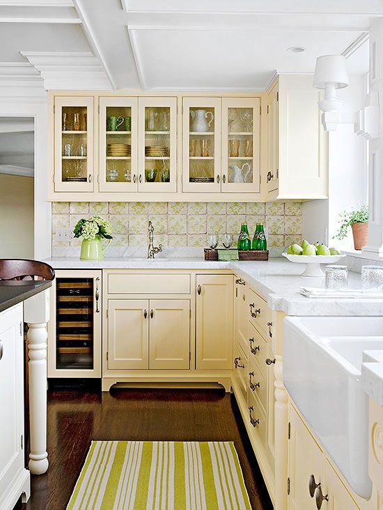 Sweetly Nostalgic Color Scheme -  Evoking nostalgia, this kitchen recalls simpler times  (I'd change the green out and go with blue; but I like the butter-cream color on the cabinets!)