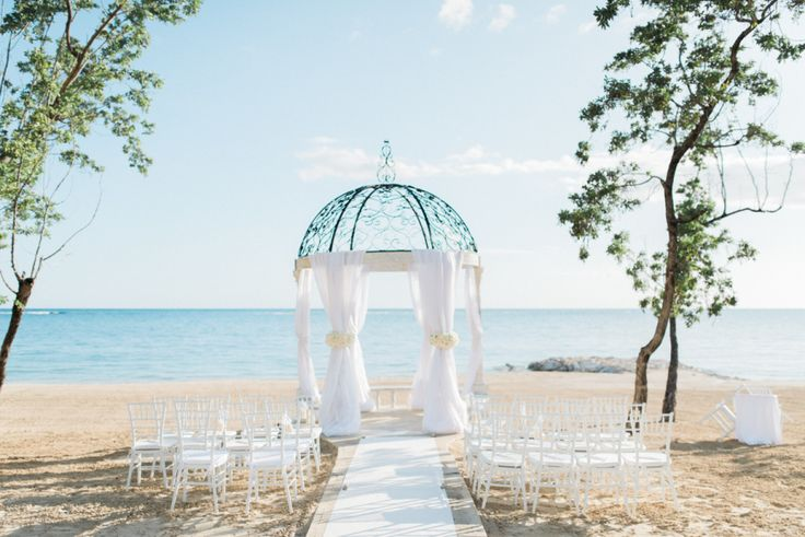 Sandals Royal Bahamian resort beach wedding ceremony: Photography: Ether & Smith - www.etherandsmith.com   Read More on SMP: http://www.stylemepretty.com/2016/08/24/white-color-palette-jamaica-destination-wedding/