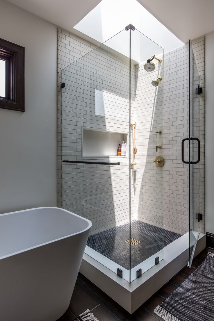 Glass-walled shower in a white modernist bath by Brian Paquette | Remodelista