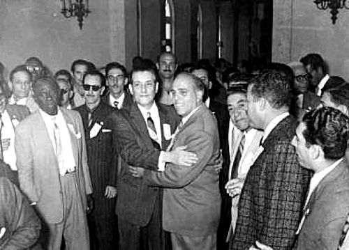 Presidential candidate Carlos Márquez Sterling (center-L) embracing Néstor Carbonell Andricaín (center-R) at Free People's Party event during 1958 Cuban elections campaign. For information about Cuban History of this period please visit Cuba 1952-1959