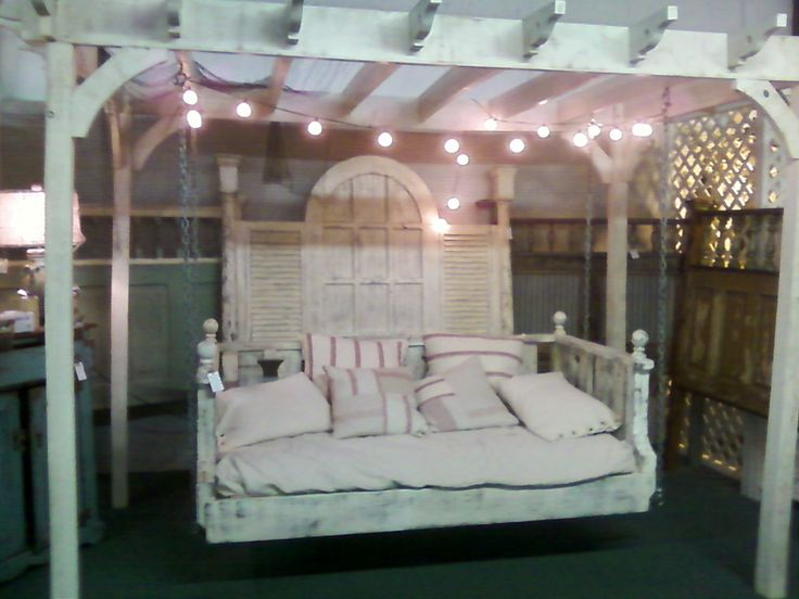 retail store display shabby chic hanging bed under a trellis