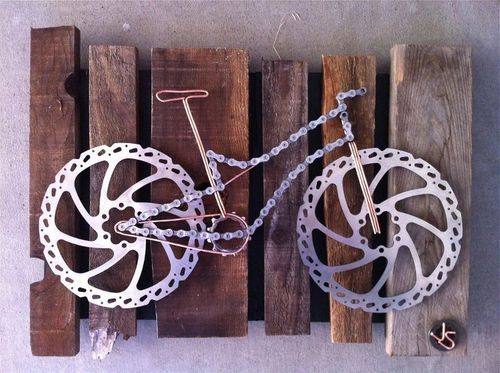 A bicycle made entirely of wire, chain, & brake discs
