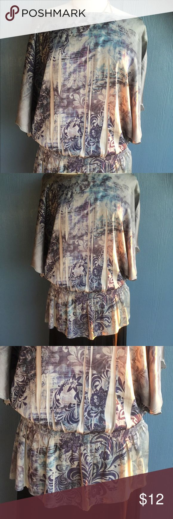 Plus size top Wide neckline that runs horizontally, front and back . Light weight silky fabric. Short sleeve bat wing style. Has a gathered waist. Excellent used condition Worthington Tops Blouses