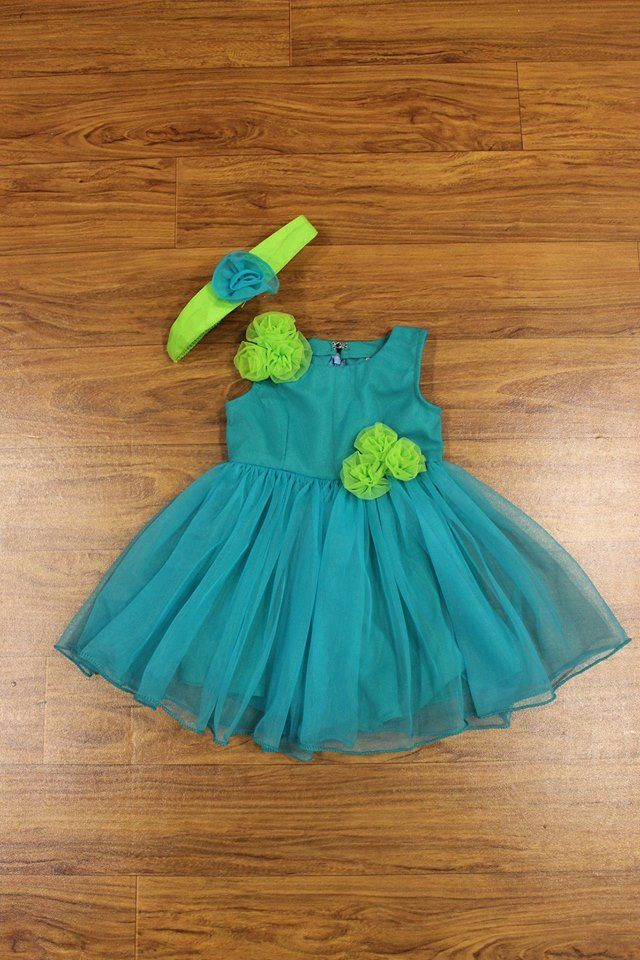 Doll up your little baby in this frilly blue and green netted frock. Comes with a matching headband adorned with netted roses.