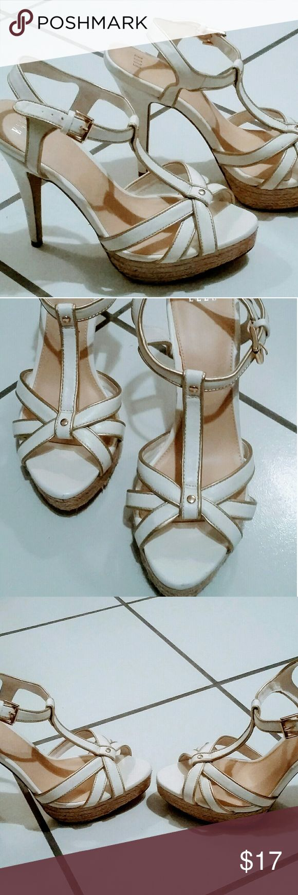 Elle brand white sandal heels 8.5 Cute n sexy Elle sandal heels with adjustable buckle. Gold outline detail. Size 8.5. Couple darker marks on the back heel but other than that in good condition . Very clean. Elle Shoes Heels