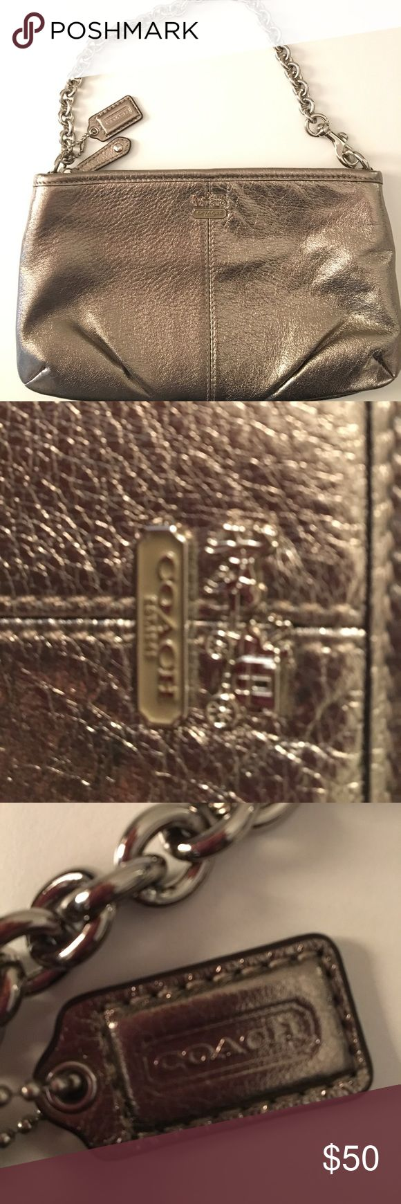 💥 AUTHENTIC COACH Pochette w/ silver link strap Barely worn small Gunmetal COACH bag with silver link chain. Interior is lined in eggplant satin. Care instructions included. Barely used. Excellent condition. Very small (barely noticeable) brush in leather. Located to bottom left of coach emblem on bag. GIFT QUALITY Coach Bags Mini Bags
