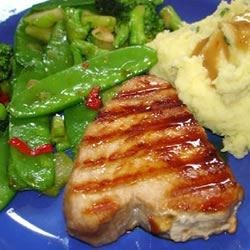 This tasty tuna marinade makes a good thing even better. Soy sauce, fresh ginger, rice wine, garlic, and oil are poured over fresh tuna steaks and left to marinate briefly in the fridge.