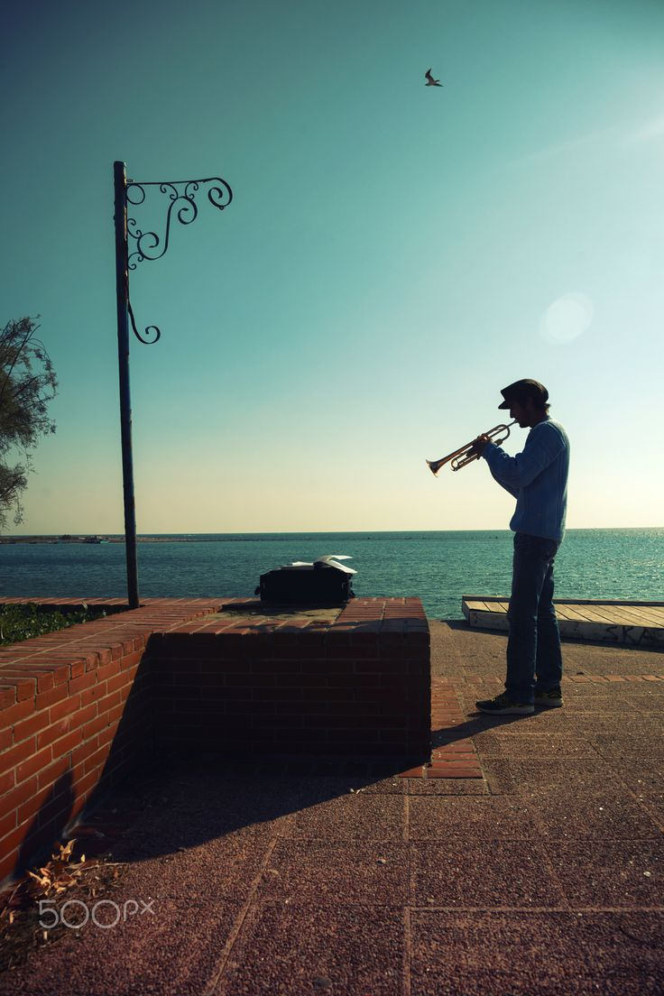 Trumpet man - Man Blowing Trumpet at a port