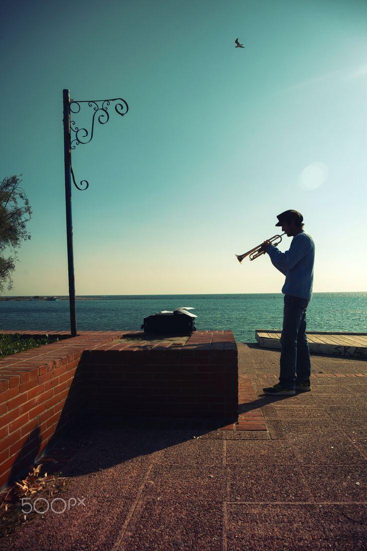 Trumpet man - Man Blowing Trumpet at a port