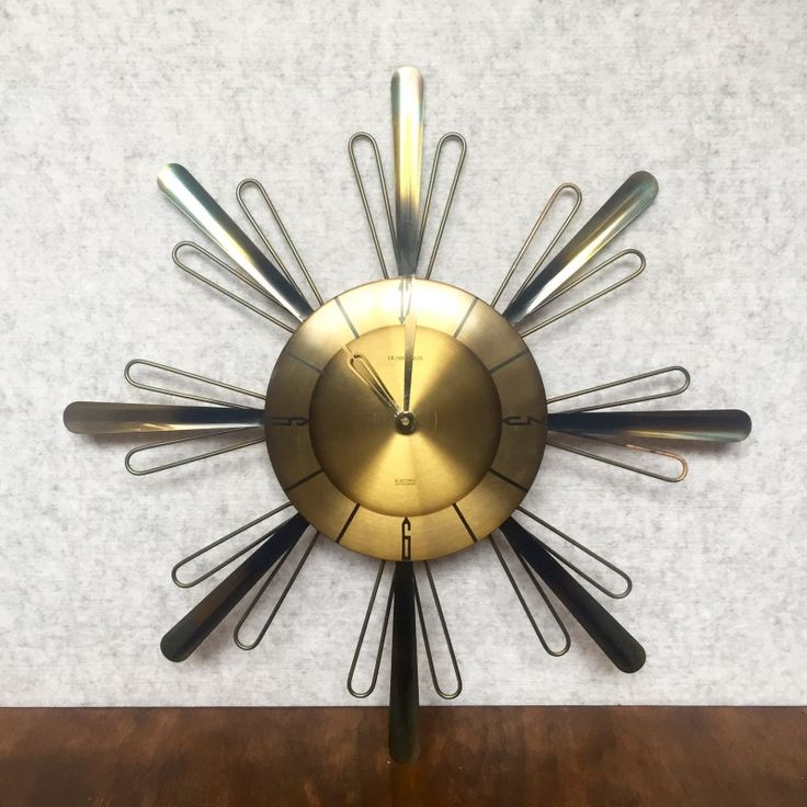 VINTAGE STARBURST STYLE WALL CLOCK BY DUNKLINGS - $75  Dunklings were started in Melbourne Australia in the late 1800s and were renowned for their fine jewellery and watches.  This Mid-century starburst style clock was made by Dunklings, using a West German Kienzle battery operated clock. Takes 1 x C cell battery.