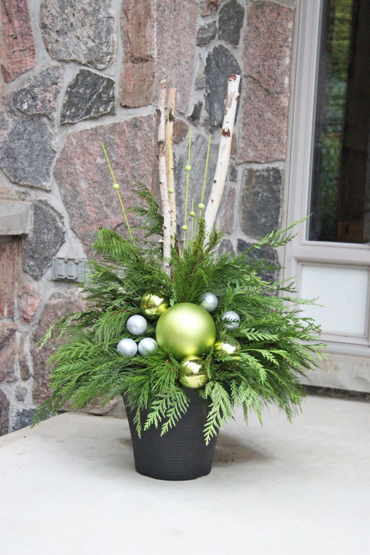 Chartreuse and silver with birch branches, Would also look neat with black branches and silver/gold balls.