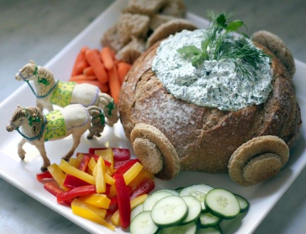 "How cute is this? Cinderella's Carriage Dip For the ""carriage"": Whole wheat boule 6 slices whole wheat bread (decoration only) For the dip: (1) 10 oz. package of frozen chopped spinach, thawed and well drained 1 ½ c. plain low-fat yogurt 1 garlic clove, minced ¼ c. each chopped fresh dill and parsley (plus extra for garnish) 1 T. fresh lemon juice 2/3 c. baby carrots for dipping 2/3 c. sliced cucumbers for dipping 2/3 c. sliced bell peppers for dipping"
