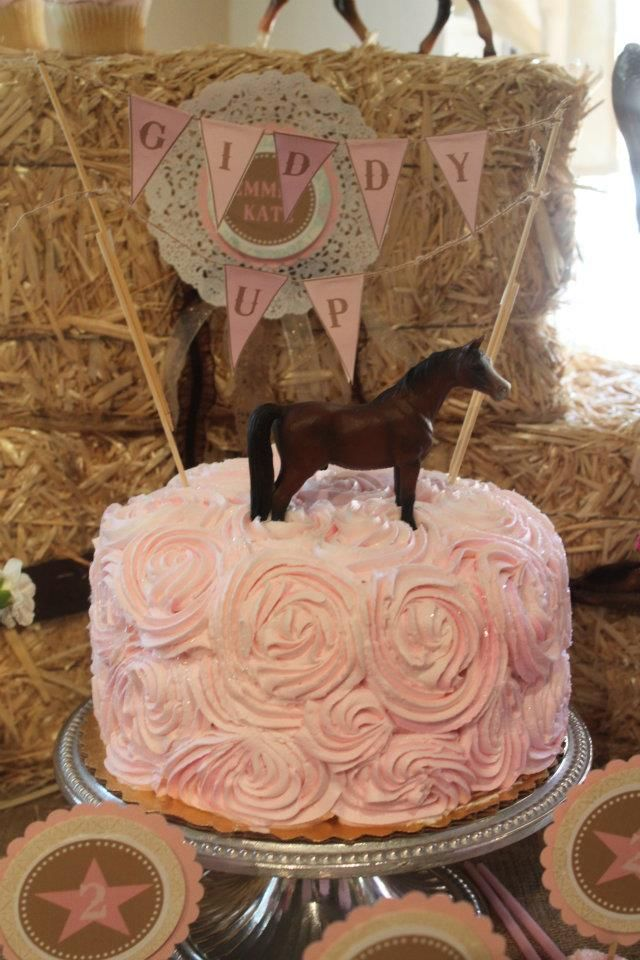 (Just a picture, no link) Simple pony cake- swirly icing & a plastic pony on top with some mini bunting! B.