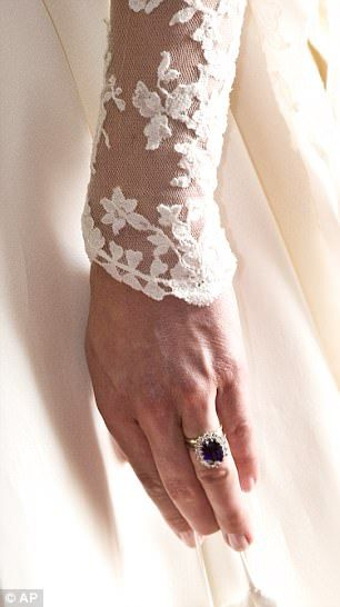 Kate's engagement and wedding rings on her finger.