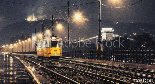 Yellow tram in the rainy night
