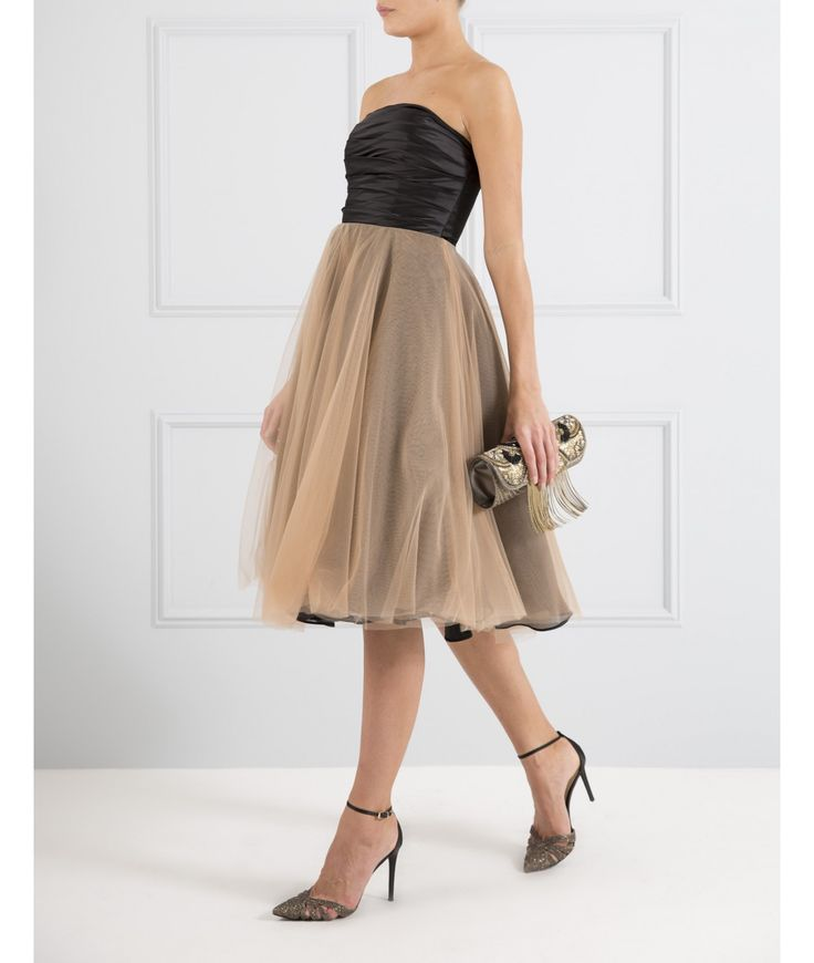 If you're looking for the perfect celebratory outfit, look no further than our black mid-length prom dress with ruched bodice and nude tulle skirt. This strapless prom dress features removable straps, bust cups, secure bust tape and an exposed gold zip fitted down the centre of the back. Wear this midi dress to your graduation or prom and claim best dressed status.