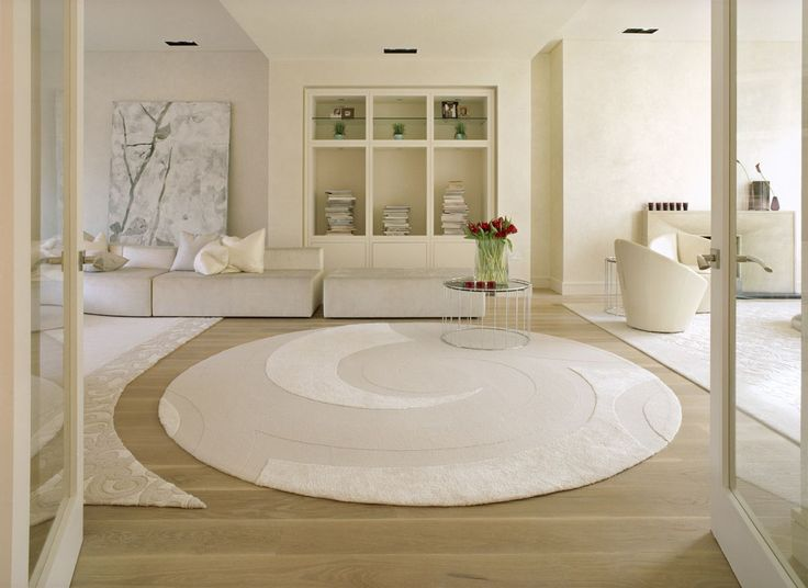 white cycle rugs and sofas for family room in modern luxury dreams house design by SHH