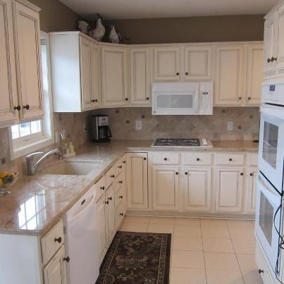 oak cabinets to white enamel with glaze cabinet refinishing ideas looking for ideas on how to transform your oak kitchen cabinets