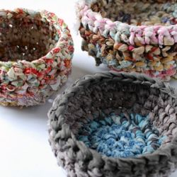 Beginner's crochet lesson. Use fabric scraps to make fabulous storage baskets. Tutorial shows how to make fabric yarn and rag rope.