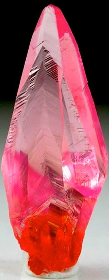 Elongated scalenohedral transparent red Rhodochrosite crystal