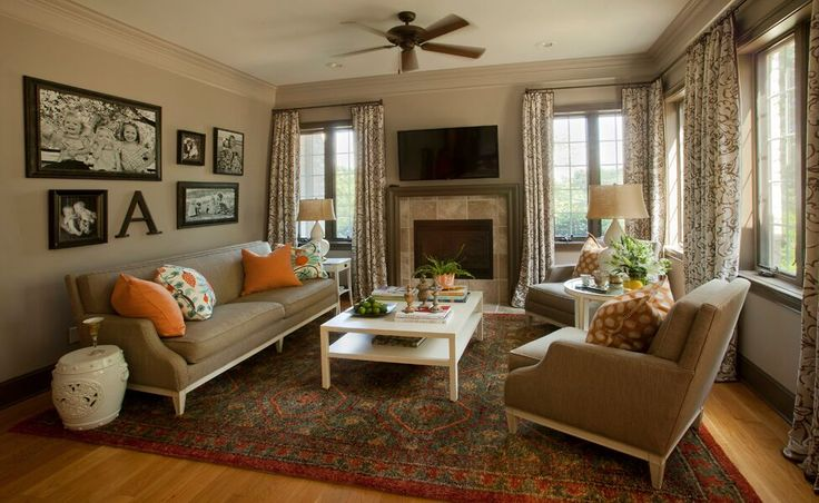 Interior designer Leslie Moore framed family photos as a gallery wall of art in the family room.