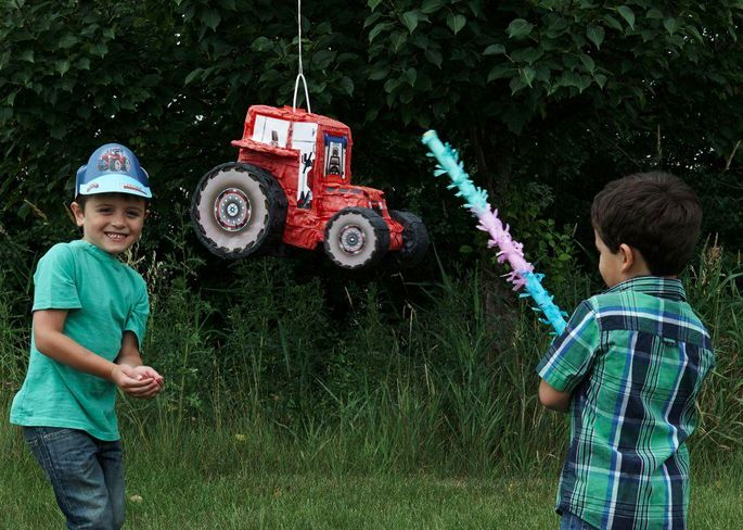 Keep all the little farmers at your little one's Farm Tractor birthday party inspired by John Deere® entertained with a giant tractor piñata. Piñatas are a fun way to shower your party guests with toys and treats. Let each little one step up and take a whack at this competitive party activity.