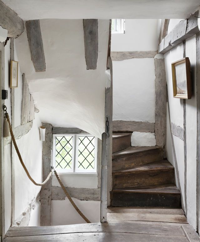 The winding 16th-century staircase leads to the second floor guest room.