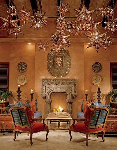 Making a Splash in Mexico : Interiors + Inspiration : Architectural Digest.  Create a similar look with our Handmade Mexican Star Lighting: http://www.lafuente.com/Lighting/Mexican-Tin-Lighting/Hanging-Stars/