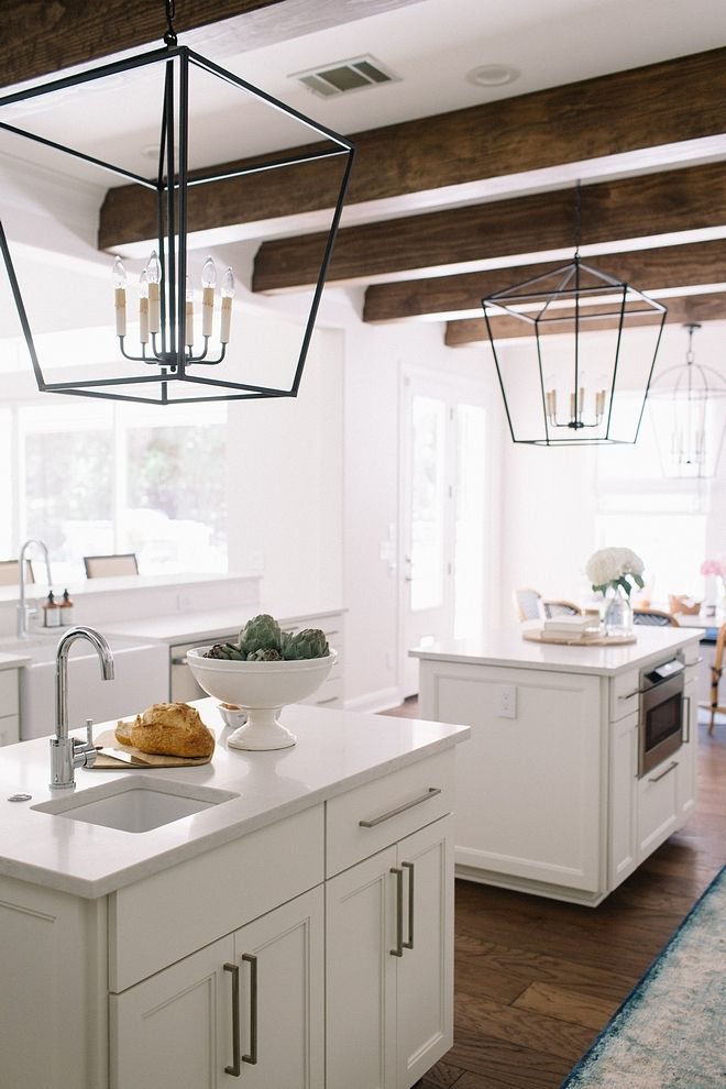Kitchen island with two prep-islands, large ceiling beams ...