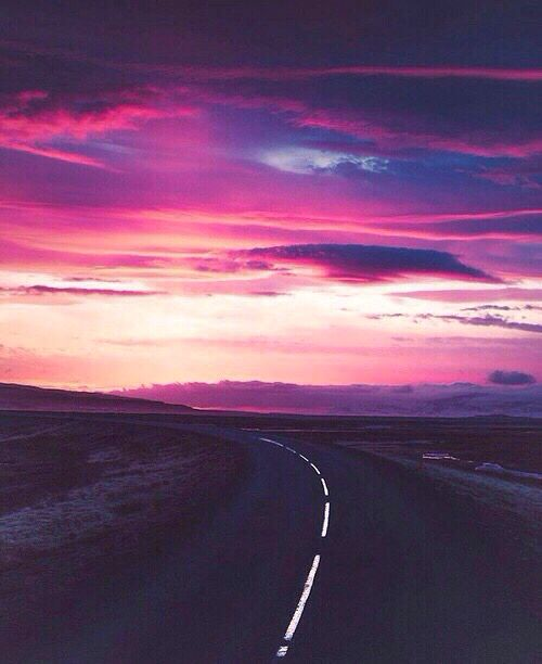 A sunset and a road.