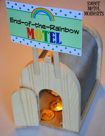 Sweet Metel Moments: Free Printable - Leprechaun Trap Signs using insect cage from Michaels craft store and attached custom-made motel signs on popsicle sticks.