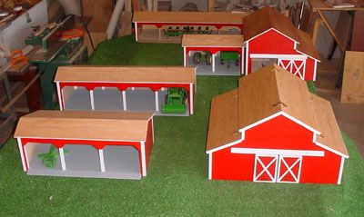 Handcrafted wooden toy barns and polesheds