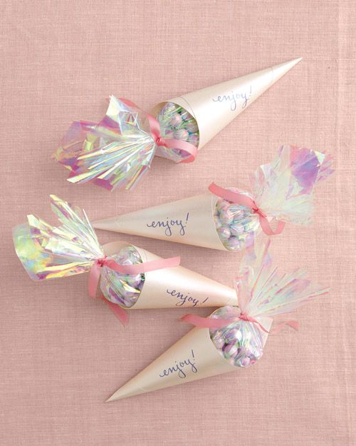Baby Shower Favors: Believe it or not, candy tastes better when it comes in a pretty package! Use our template to create these paper cones in the color of your choice -- we suggest blue or pink, depending on the soon-to-arrive baby.
