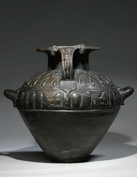 Etruscan bucchero hydria, 6th century B.C. Of broad rounded form with single pouring handle and twin lifting handles, the body molded in relief with lions, tongues and teardrop-shaped ornaments, 42 cm high. Private collection