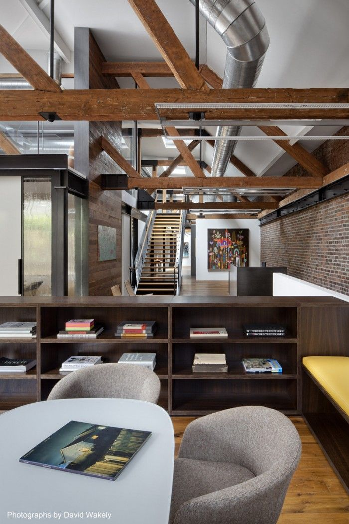 Huntsman Architectural Group recently completed the design and installation of a larger office space for San Francisco-based creative agency Tolleson. The office's design uses the 1910 warehouse's rustic office aesthetic, with skylights, wood floors, exposed timber trusses and brick walls to create an environment which better suits the firm's client engagement, collaborative work, and technical production needs.