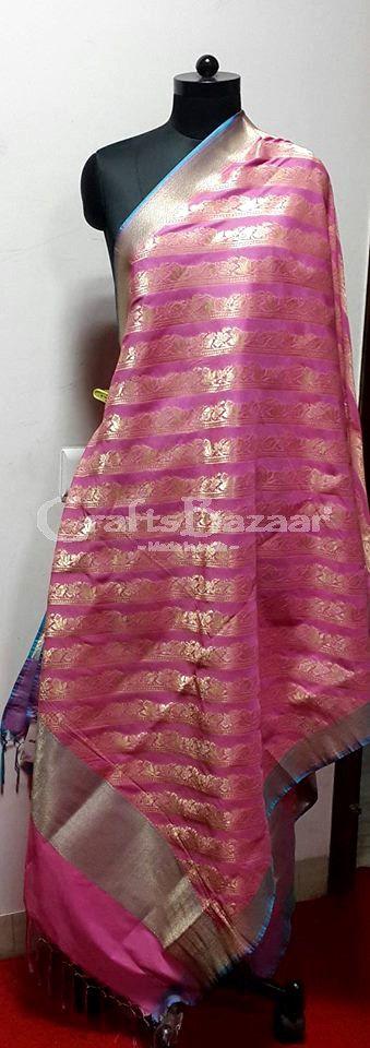 Weave of  Gold Zari on Pink Pure Silk Dupatta. Pink is Forever...Beautifully weaved Dupatta ideal for Wedding/ Party/ Shagun/FestivalIndian Traditional, Ethnic and Luxurious Shawls and Stoles at CraftsBazaar Made in India Online include Kashmiri Embroidert Pashmina Sozni, Kani, Papier Mache Shawls and Stoles, Jamavaar Shawls, Gujarati Kuttchi Shawls, Jaipuri Bandhani, Leheriya, Ajrakh and Block printing in silk, Chanderi, Maheshwari, Cotton and Wool.Indian Traditional, Ethnic a...