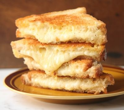 The secret to making the ultimate grilled cheese sandwich is cooking it over low heat, which brings out the subtle flavors of the cheese, and slathering the bread with butter, which crisps it in the pan.