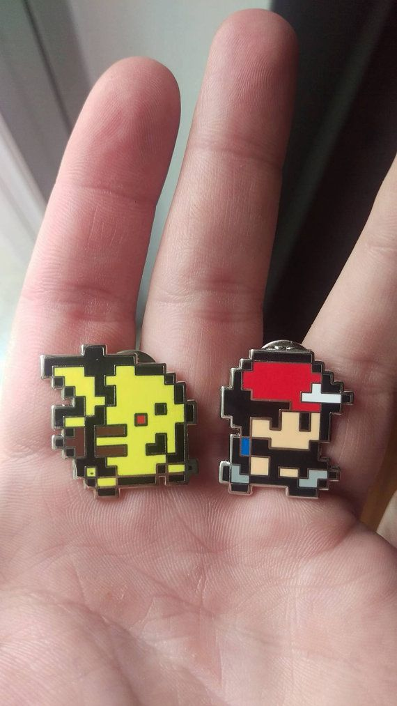 Matching 2 pin set :)  For all my 90s kids <3 Ash and Pikachu from the old Pokemon games, particularly Pokemon yellow =]  Hard enamel 2 pin set, 1 inch tall and proportionally wide!! Double posted and each numbered sequentially xx/150!!  <3