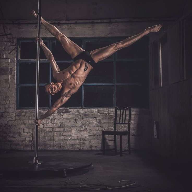 Danny Charge on an @Xpole #XStage. Image by FACEIRO - Chris Underwood #meninpole #menwhopole #poledanceforeverybody