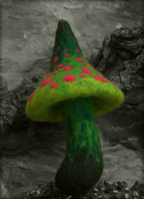 This mushroom is first needle felted and after that wet felted to be more durable.It measures about 8cm *14cm